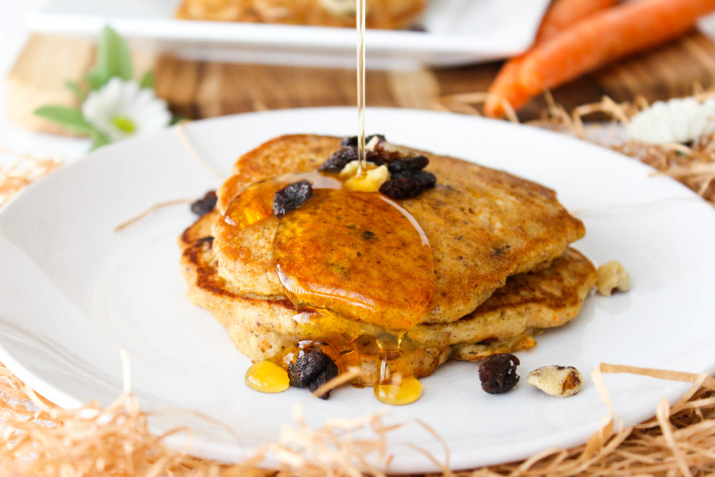 Carrot Cake pancakes! Light, fluffy, and loaded with goodies. www.goodandguiltyvegan.com